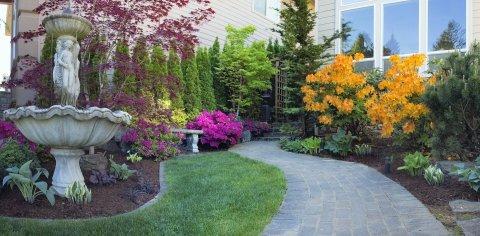 Custom Designed Seasonal Color Landscaping With Stone Path, Fountain, Trees, Shrubs, And Beautiful Multi-colored Flowers