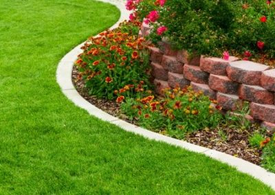 Tiered Garden Bed With Flowers And Shrubs And A Manicured Lawn