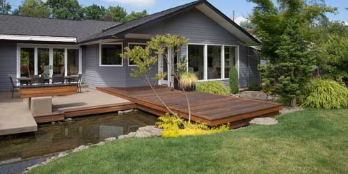 Home With Water Feature And Custom Designed Landscaping